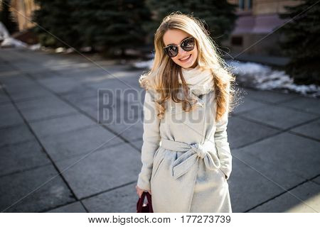 Outdoor Portrait Of A Young Beautiful Fashionable Happy Lady Posing On A Street Of The Old City. Mod