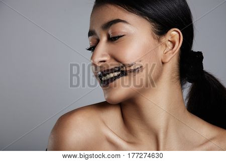 profile portrait of mixed race woman with a lip scrub