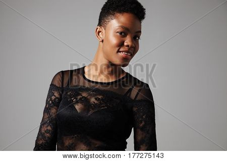 pretty black woman with a strobbing shiny healthy skin
