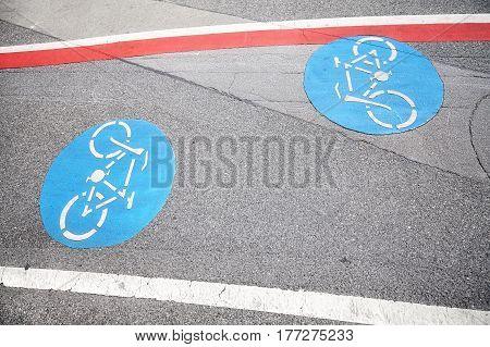 Bicycle Lane Blue Sign On An Asphalt Street