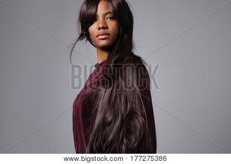 serious black mixed race woman wears wig