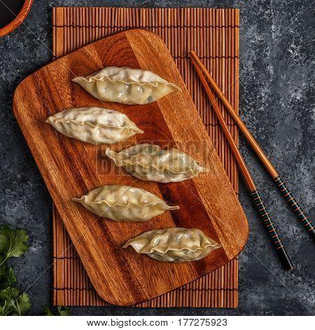 Fresh Dumplings On A Dark Stone Background.