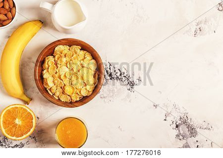 Healthy Breakfast - Bowl Of Corn Flakes, Nuts And Fruit