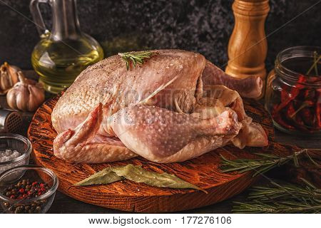 Raw Chicken On Wooden Cutting Board