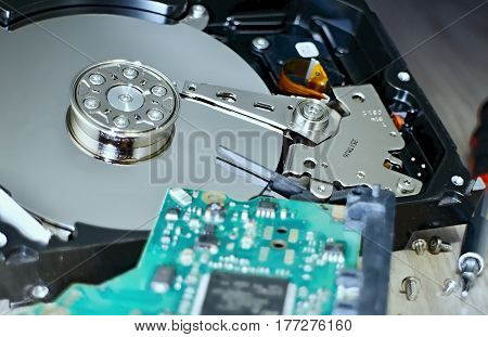 Open Hard Disk Drive with a visible memory plate and the read head. Hard Disk Drive with internal mechanical design.
