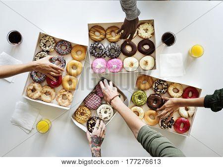 People Hands Reach Our Grabbing Doughnut