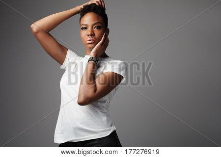 rock style black woman with hands touching head