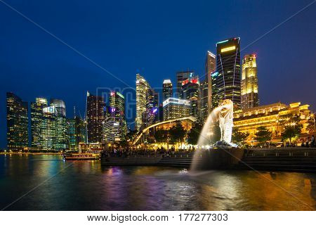 Singapore - June 24, 2016: Singapore skyline, Marina bay and Merlion fountain view at dusk