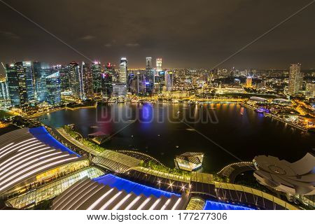 Singapore - June 25, 2016: Singapore financial district and Marina bay aerial view at sunset