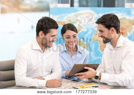 Young man and couple sitting in office travel agency poster