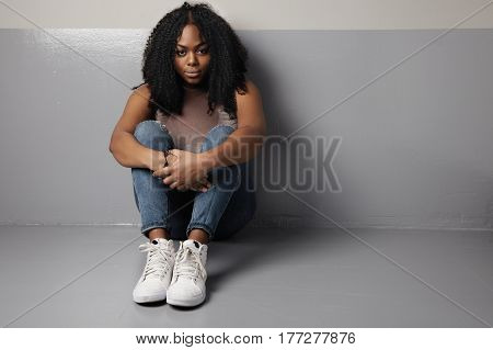plus size woman sits on the floor