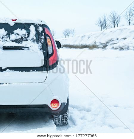 Car stuck in snowdrift on winter road