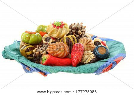 some different sweets on a colored dish