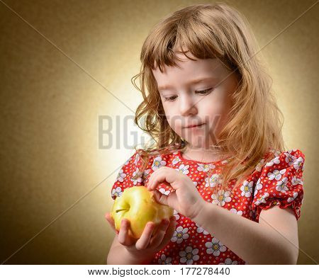 Studio Portrait Of A Little Girl With An Apple
