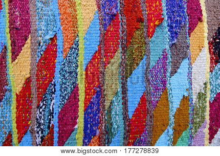 traditional Rajasthani colorful cotton fabric durries woven from recycled saree materials