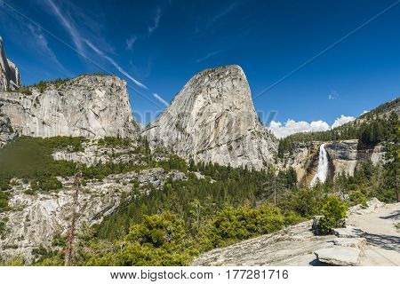 Beautiful Nevada Falls is located on Merced river and under mighty Liberty Dome grantite cap. Yosemite National Park, California, USA