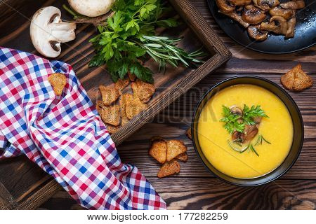 Pea Soup With Mushrooms In Black Plate.
