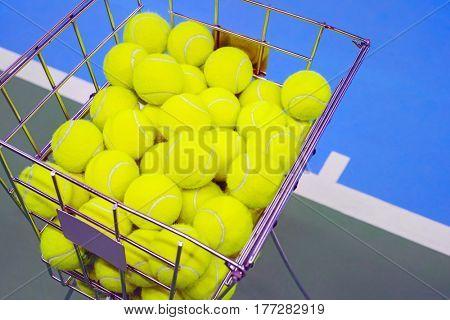 Tennis court with a ball basket , close up