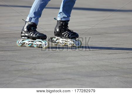 the legs rolling around on roller skates