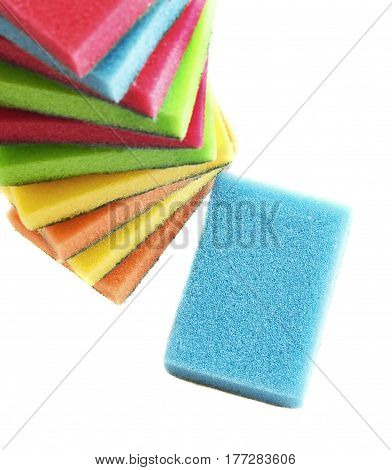 Multicolored sponges for washing dishes on white isolated background