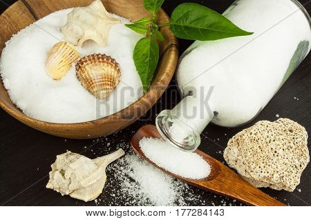 Fine sea salt on a wooden table. Spices on the table. Sales flavors