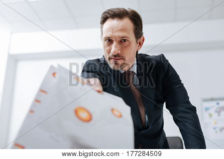 Redoing this immediately. Furious irritable confident boss standing in the office and throwing documents about while expressing fierce