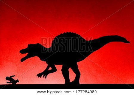 shadow of spinosaurus chasing human on wall in red no logo or trademark