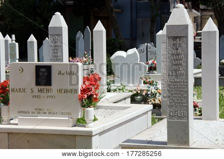 MOSTAR, BOSNIA AND HERZEGOVINA, MAY 12, 2010: Cemetery with the graves of the war in 1993. Around 2,000 people died in Mostar during the war