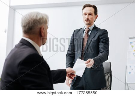 Quitting my job. Experienced aged confident employee giving a dismiss notification to the employer and expressing confidence while sitting in the office