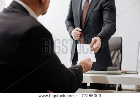 My voluntary withdrawal. Confident diligent honest employee giving the dismiss notice to employer and sitting in the office while having conversation