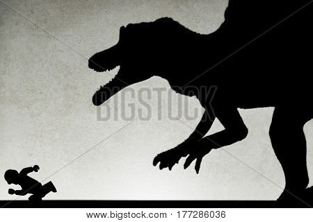shadow of spinosaurus chasing human on wall no logo or trademark