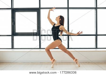 Woman dancer at a training session. Ballerina. Preparing for the competition. Classes in single sports.