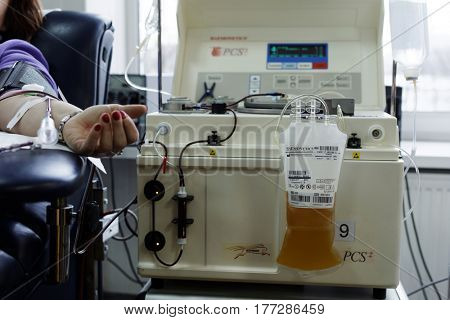 ST. PETERSBURG, RUSSIA - FEBRUARY 20, 2017: Donor gives blood plasma in the city blood transfusion station. This year the station celebrates its 65th anniversary
