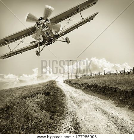 vintage biplane over a field against the sky