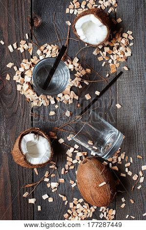 Coconut Water And Coconuts On The Brown Wooden Table