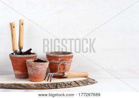 Garden Tools On The White Wooden Shelf