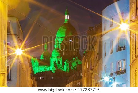 The Basilica Sacre Coeur lit with green light for celebrate St Patrick's Day, Paris, France