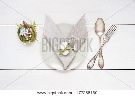 Easter Table Decoration With Napkin In The Form Of Rabbit Ears, Eggs And Nests.