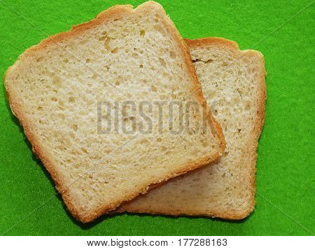 Slices of bread on the green background