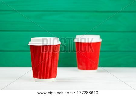 two blur red paper cardboard coffee Cup texture green