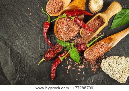 Dried chili peppers and red Hawaiian salt. Sale of spices. Advertising for the sale of spices