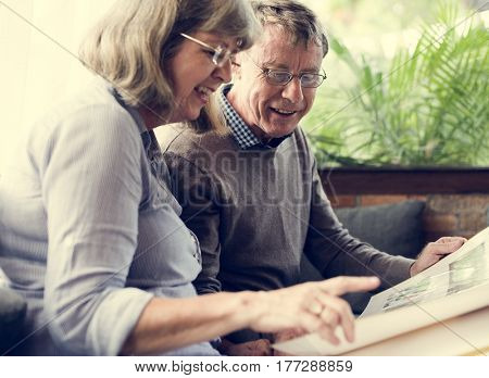 Mature Couple Reading Books Together