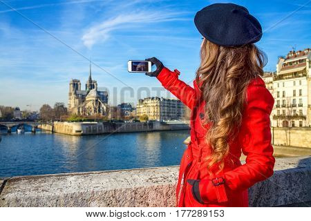 Seen From Behind Young Woman In Paris Taking Photo