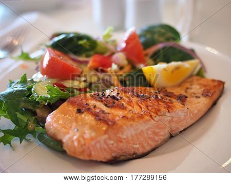 an image of a plate of food that is fish fillet. a delicious dish represented a beautiful picture.