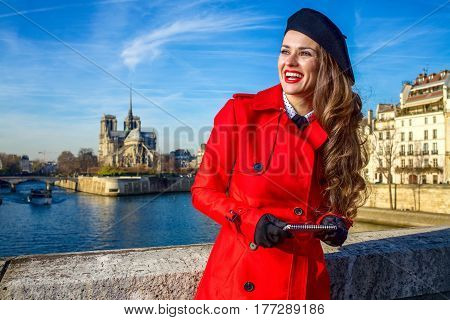 Tourist Woman In Paris Looking Into Distance And Writing Sms