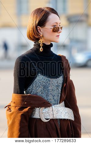 MOSCOW RUSSIA - MARCH 14 2017: People demonstrating street style fashion near Moscow Manege at Mercedes-Benz Fashion Week Russia.