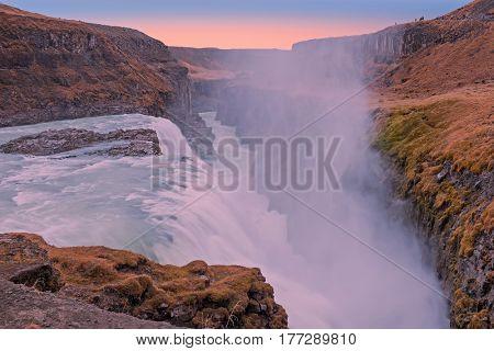 Powerfull Gullfoss Waterfalls in Iceland at sunset