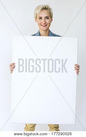 Happiness woman holding blank banner studio portrait poster