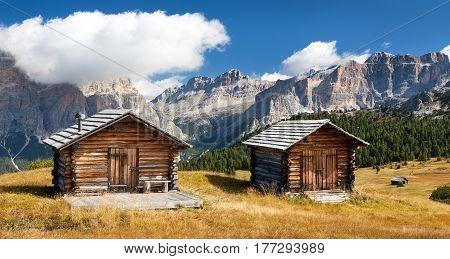 wooden small cabin in dolomities alps mountains Italian dolomiti Italy