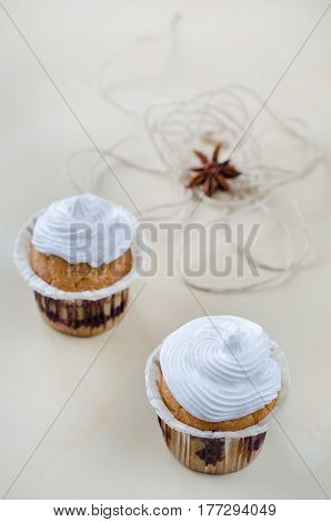 Cakes With Cream On Wooden Board